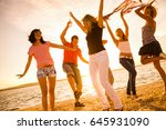 group of happy young people... | Shutterstock . vector #645931090