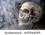 human skull with cigarette | Shutterstock . vector #645946099