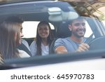 group of happy friends on a car   Shutterstock . vector #645970783