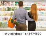 rearview shot of a loving...   Shutterstock . vector #645974530