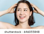 beautiful woman massaging her... | Shutterstock . vector #646055848