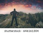 hiker stays on a rocky ridge... | Shutterstock . vector #646161304