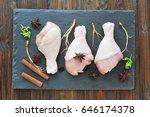 raw chicken legs with seasoning ...   Shutterstock . vector #646174378