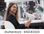 woman drying hair in electronic ... | Shutterstock . vector #646181023