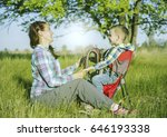 mother with baby in backpack... | Shutterstock . vector #646193338