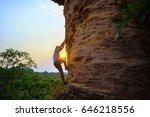 man climbing on the rock at... | Shutterstock . vector #646218556