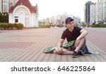 young man with a skateboard on... | Shutterstock . vector #646225864