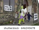 British Asian Muslims Entering...