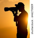 man photographer with a camera...   Shutterstock . vector #646270009