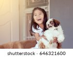 Stock photo cute asian little girl with her shih tzu dog in vintage color tone 646321600