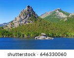 Small photo of High scaur Okzhetpes and mysterious sphinx Zhumbaktas (puzzle-stone) on Lake Auliekol (Borovoe) are located in Burabay National Nature Park in the Republic of Kazakhstan. Beautiful mountain landscape.