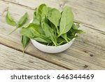 spinach in a white bowl on a... | Shutterstock . vector #646344469