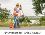 land surveyor looking through... | Shutterstock . vector #646373380