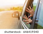child hands in a car window... | Shutterstock . vector #646419340