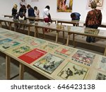 "Small photo of KIEV - UKRAINE - MAY 2017: Art and book exhibition in Arsenal museum in Kiev. Visitors of the exhibition view the exposition of the satirical almanac ""Pepper""."