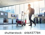 woman walking with a luggage... | Shutterstock . vector #646437784