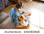 father and son with smartphone... | Shutterstock . vector #646482868