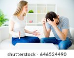loving couple swears on the sofa | Shutterstock . vector #646524490
