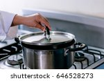 women hands opening kitchen pot ... | Shutterstock . vector #646528273