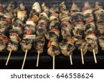 skewers on barbecue grill | Shutterstock . vector #646558624