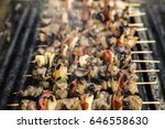 skewers on barbecue grill | Shutterstock . vector #646558630