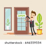 "businessman hang a sign ""open""... 