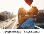 couple in love cuddling while... | Shutterstock . vector #646563850