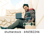 young indian man using laptop... | Shutterstock . vector #646582246