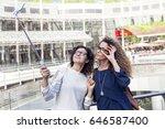 two smiling lovely girls takes... | Shutterstock . vector #646587400