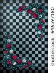 Stock photo red roses and white roses on chess background wonderland background rose flower frame 646597180