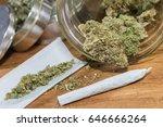 rolling marijuana joints   hand ... | Shutterstock . vector #646666264