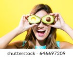happy young woman holding... | Shutterstock . vector #646697209