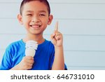 cute boy holding light bulb in... | Shutterstock . vector #646731010