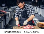 Bearded Butcher Dressed In A...