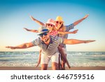 happy family on the beach.... | Shutterstock . vector #646759516