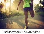young female runner warming up... | Shutterstock . vector #646897390