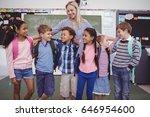 happy teacher standing with... | Shutterstock . vector #646954600