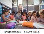 teacher helping schoolgirl with ... | Shutterstock . vector #646954816