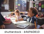 teacher interacting with... | Shutterstock . vector #646960810