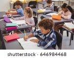 attentive schoolkids doing...   Shutterstock . vector #646984468