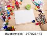 paints  brushes and palette on... | Shutterstock . vector #647028448