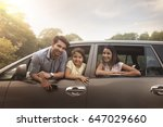 family looking out car window  | Shutterstock . vector #647029660