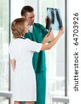 medical doctors analysing x ray ... | Shutterstock . vector #64703926