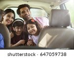 happy family travelling in car   | Shutterstock . vector #647059738