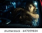 woman in car night light sit... | Shutterstock . vector #647059834