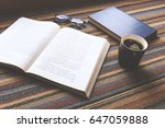 cup of coffee and book on... | Shutterstock . vector #647059888