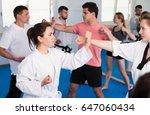 men and women fighting in pairs ... | Shutterstock . vector #647060434