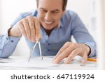 close up of compasses in hands...   Shutterstock . vector #647119924