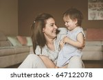 single mother playing with her... | Shutterstock . vector #647122078