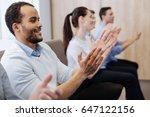 happy handsome man applauding | Shutterstock . vector #647122156